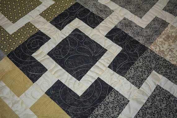 Quilt sin botones con diseño geométrico