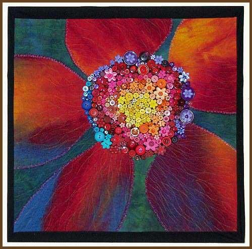 Diseño de quilt artístico con botones de colores