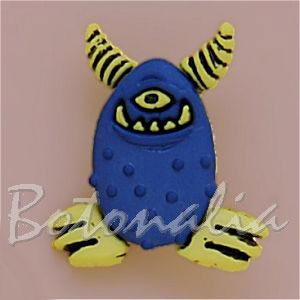 Botón con forma de monstruo azul y amarillo