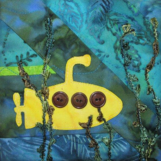 Bloque de quilt con aplique de submarino y botones