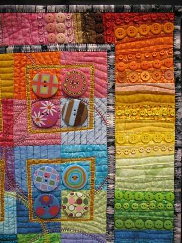 Sample of quilt with many colorful buttons