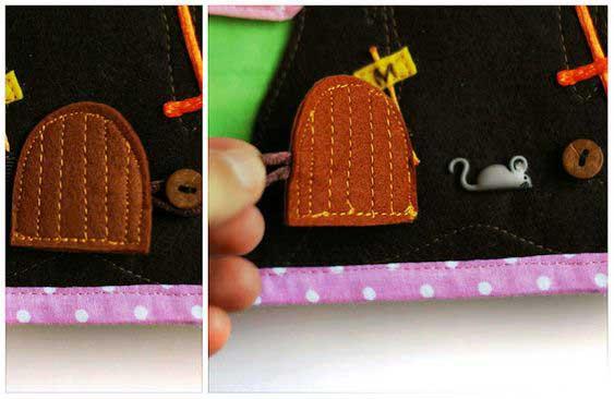 Botón con forma de ratón en libro de tela para niños