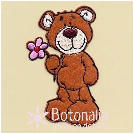 Teddy bear with a flower