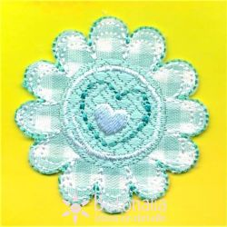 Flower in green gingham with a heart.