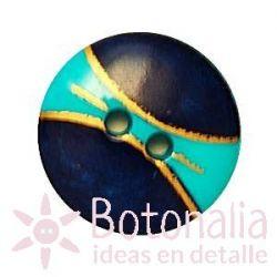 Botón con dibujo dorado sobre tonos azules.