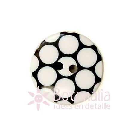 Black button with a polka dot design in white 18 mm.