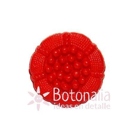 Botón rojo decorado.