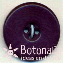 Classic round button with a smooth design in purple