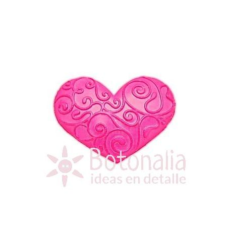 Decorated heart in pink.
