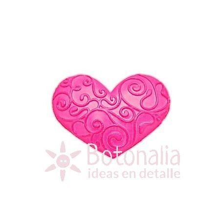 Corazón decorado rosa.