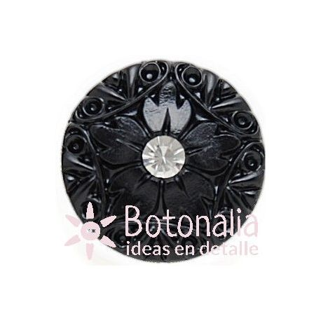 Button in black with a carved decoration 36 mm
